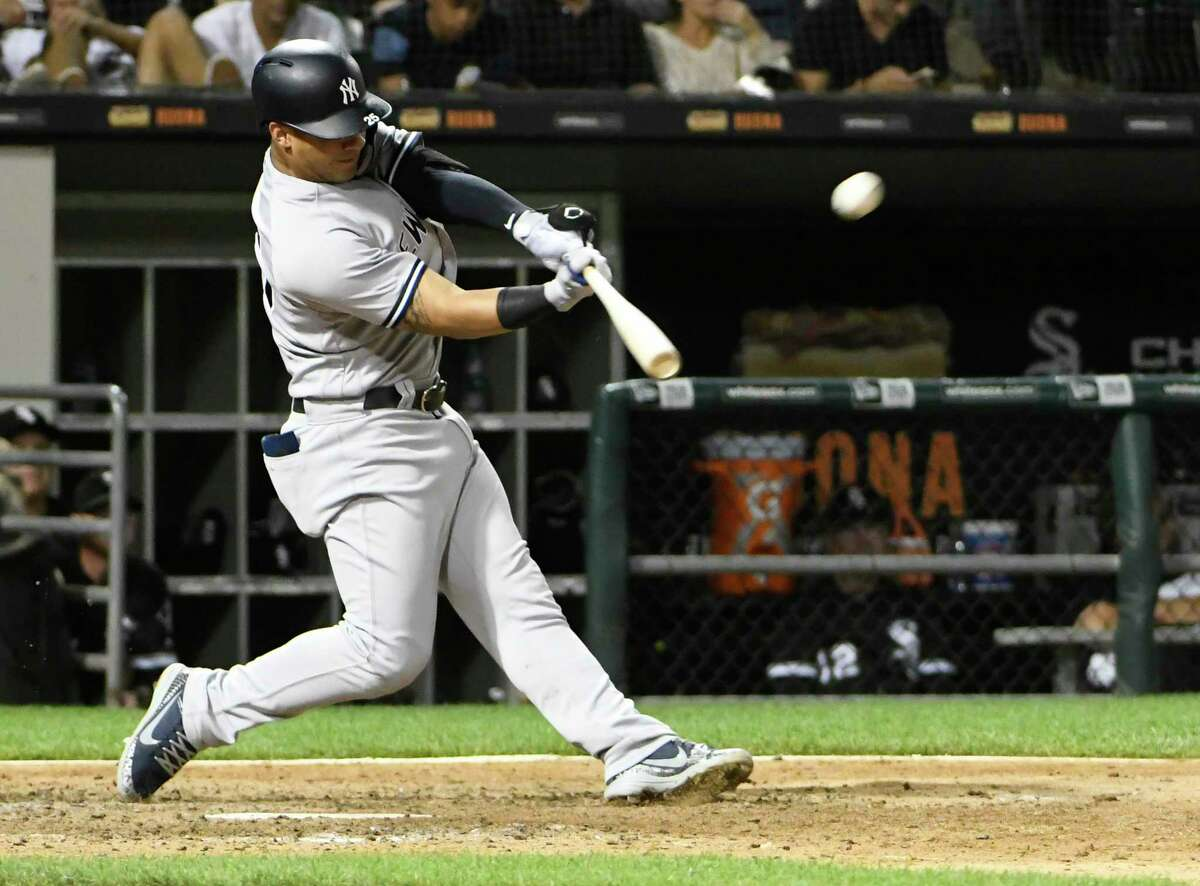 New York Yankees' Gleyber Torres (25) hits a home run against the Chicago White Sox during the eighth inning of a baseball game, Monday, Aug. 6, 2018, in Chicago. (AP Photo/David Banks)