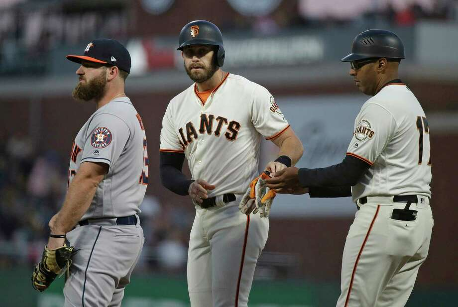San Francisco Giants' Evan Longoria stands at first base with coach Jose Alguacil, right, after hitting a single off Houston Astros starting pitcher Charlie Morton in the fourth inning of a baseball game Monday, Aug. 6, 2018, in San Francisco. At left is Houston Astros first baseman Tyler White. (AP Photo/Eric Risberg) Photo: Eric Risberg, Associated Press / Copyright 2018 The Associated Press. All rights reserved