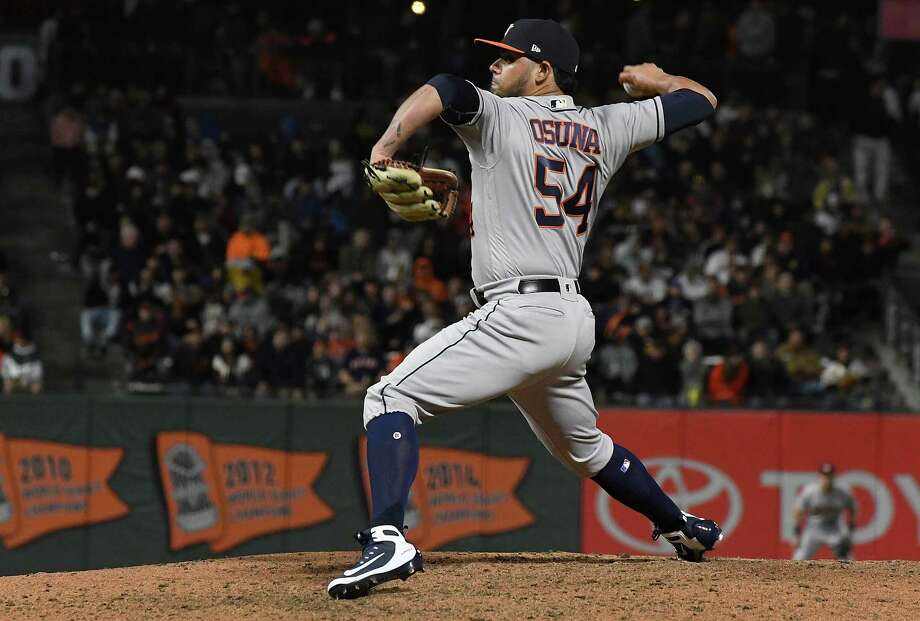 PHOTOS: What we know about Roberto Osuna so far SAN FRANCISCO, CA - AUGUST 06: Roberto Osuna #54 of the Houston Astros pitches against the San Francisco Giants in the bottom of the eighth inning at AT&T Park on August 6, 2018 in San Francisco, California. Photo: Thearon W. Henderson, Getty Images / 2018 Getty Images