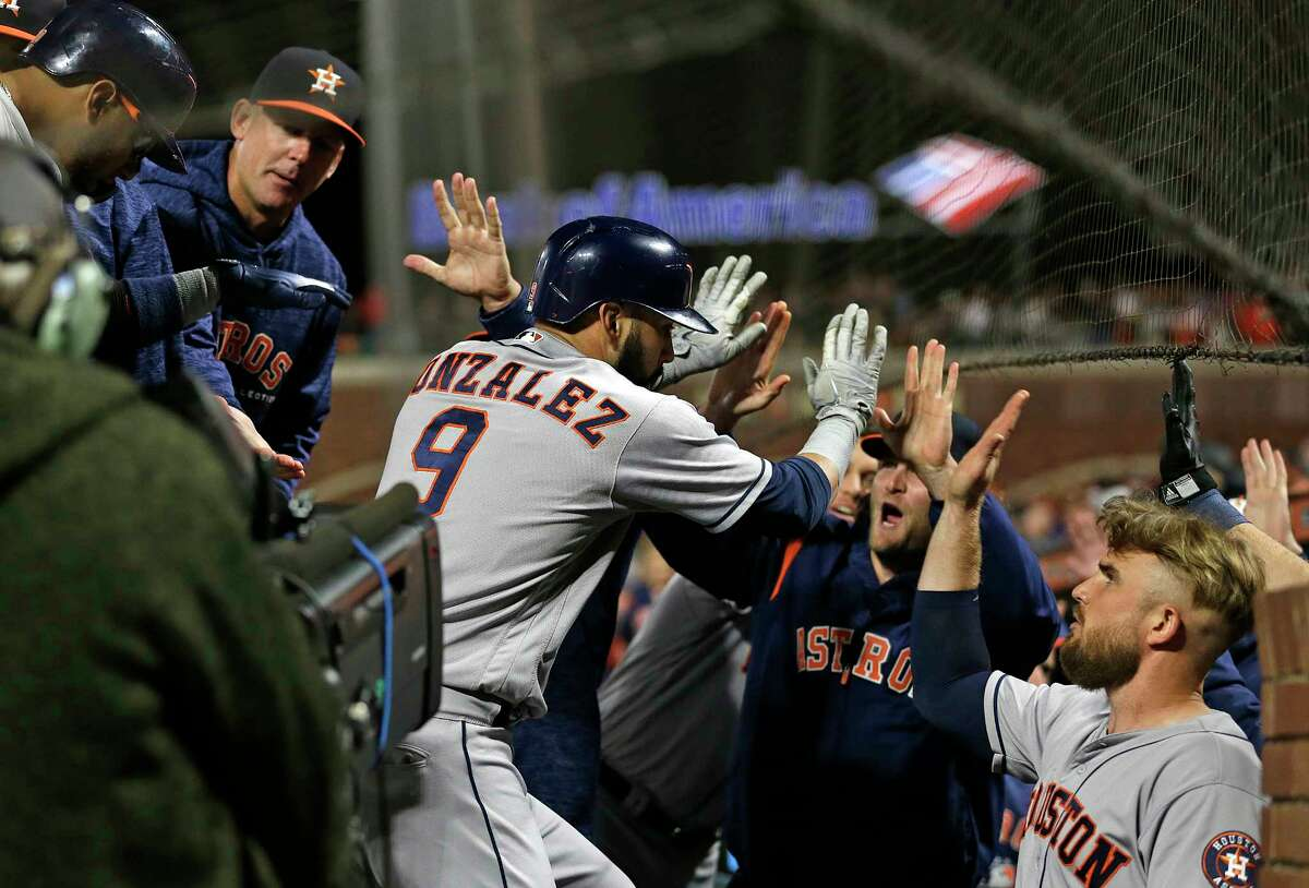 Houston Astros' Marwin Gonzalez is greeted by his teammates in the dugout after hitting a three-run home run off San Francisco Giants relief pitcher Will Smith in the ninth inning of a baseball game, Monday, Aug. 6, 2018, in San Francisco. (AP Photo/Eric Risberg)