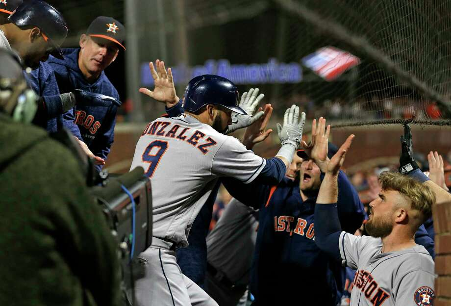 Houston Astros' Marwin Gonzalez is greeted by his teammates in the dugout after hitting a three-run home run off San Francisco Giants relief pitcher Will Smith in the ninth inning of a baseball game, Monday, Aug. 6, 2018, in San Francisco. (AP Photo/Eric Risberg) Photo: Eric Risberg, Associated Press / Copyright 2018 The Associated Press. All rights reserved