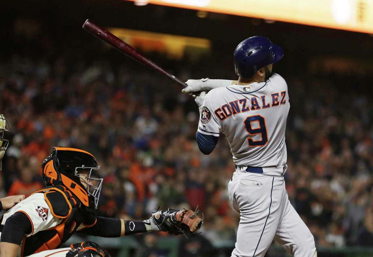 Houston Astros' Marwin Gonzalez hits a three-run home run off San Francisco Giants relief pitcher Will Smith in the ninth inning of a baseball game, Monday, Aug. 6, 2018, in San Francisco. Looking on at left is San Francisco Giants catcher Buster Posey. (AP Photo/Eric Risberg)
