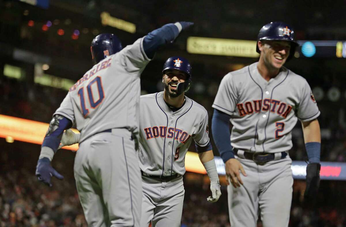 Houston Astros' Marwin Gonzalez, center, is greeted by teammates Yuli Gurriel, left, and Alex Bregman (2) after hitting a three-run home run off San Francisco Giants relief pitcher Will Smith in the ninth inning of a baseball game, Monday, Aug. 6, 2018, in San Francisco. (AP Photo/Eric Risberg)