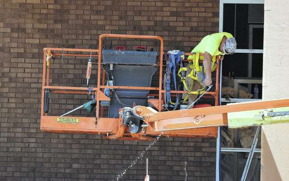 Construction crews work Monday to finish renovation projects at South Jacksonville Elementary School ahead of the start of the school year later this month. Photo:       Samantha McDaniel-Ogletree   Journal-Courier