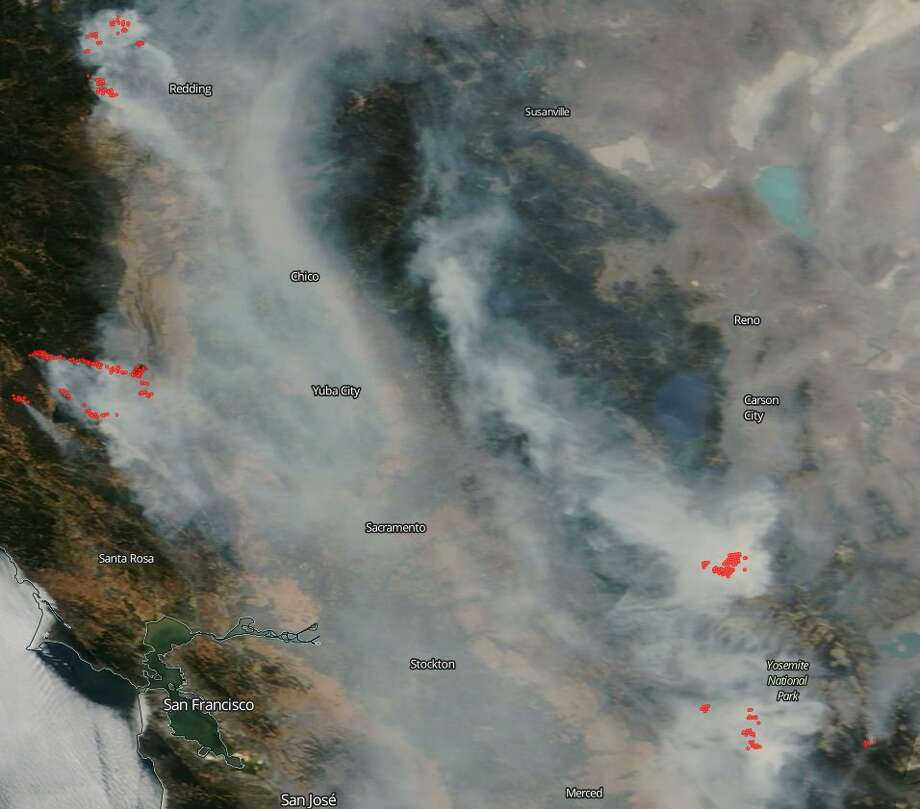 "Sacramento Air Quality Management District: ""This shot from @NASAEarth says everything. Avoid outdoor activity until the smoke lifts or blows out."" Photo: Sacramento Air Quality Management District"