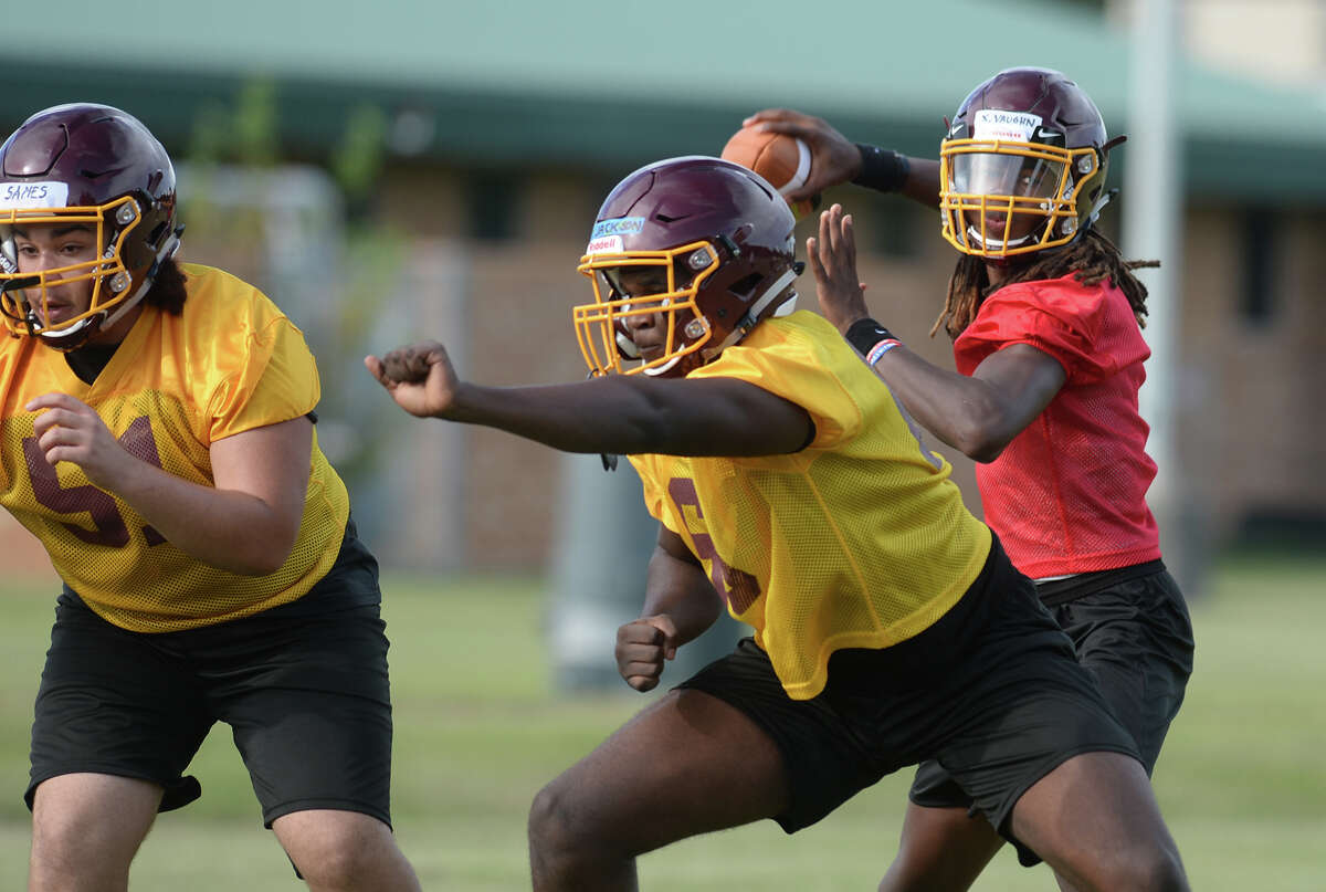 Beaumont United players run drills and plays during the school's first practice on Monday. Photo taken Monday, 8/6/18