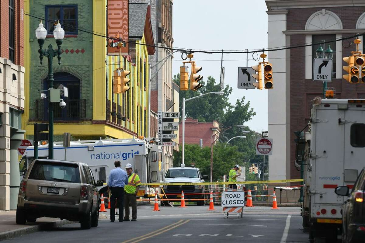 National Grid crews work on underground electrical lines on State Street at Broadway after manhole covers blew earlier in Tuesday Schenectady.