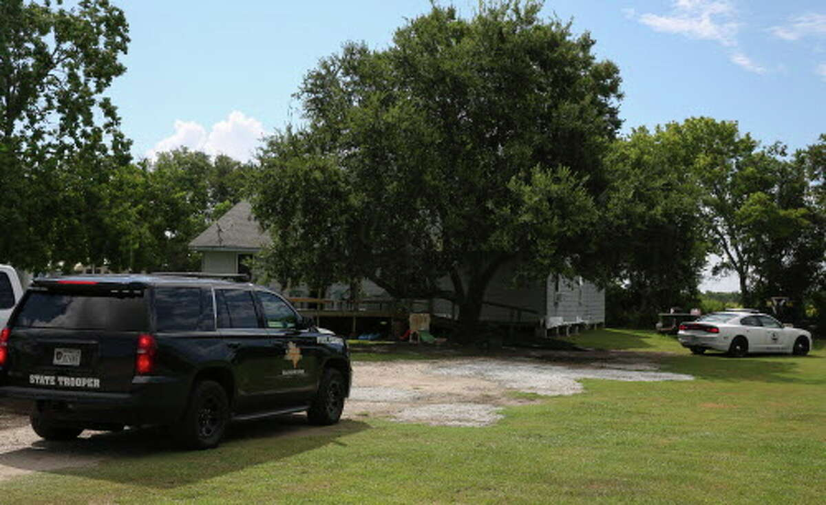 The Chambers County Sheriff's Office and Baytown police were on the scene where they found missing Baytown Officer John Stewart Beasley's body in a grass field behind a house in the 6300 block of FM 565 on Tuesday, Aug. 7, 2018, in Cove.