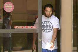 Gabriel Robert Ortiz, 29, leaves the federal courthouse in San Antonio on Thursday, July 26, 2018. He and fellow former Bexar County Detention Center guard Ruben Hernandez have been arrested on federal charges for their alleged roles in helping bring drugs into the Bexar County jail.