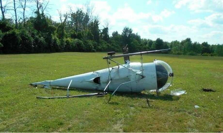 Two men suffered minor injuries in a helicopter accident Friday in Midland.