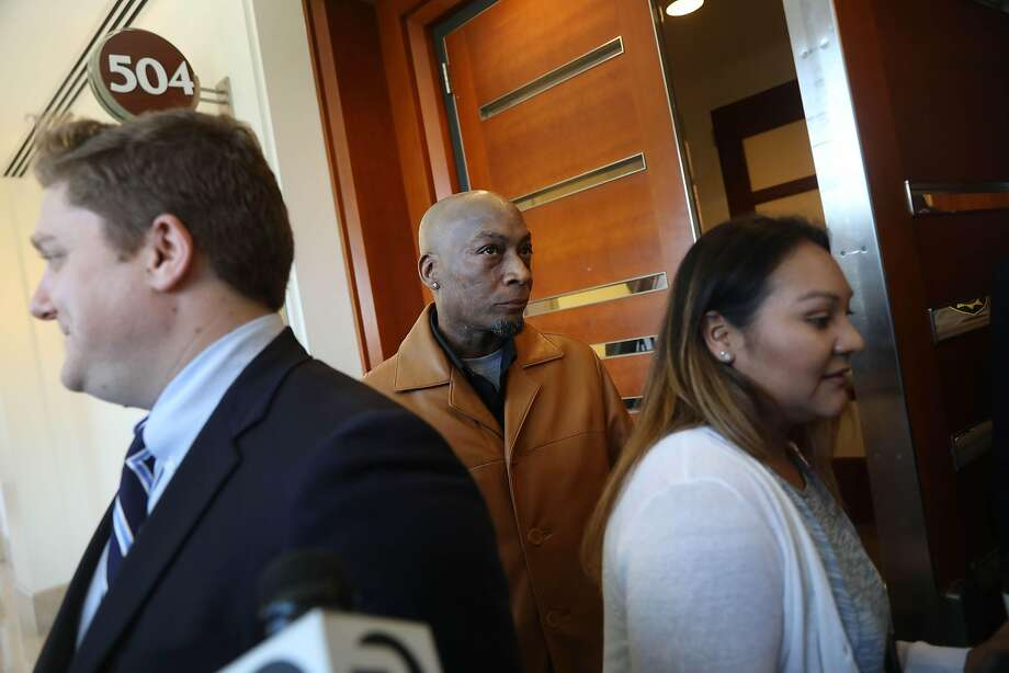 Dewayne Johnson (center), former groundskeeper for the Benicia Unified School District, leaves Department 504 with his wife Araceli Johnson (right) behind attorney Brent Wisner (left) at Superior Court of California during the Monsanto trial on Monday, July 23,  2018 in San Francisco, Calif. Photo: Lea Suzuki / The Chronicle