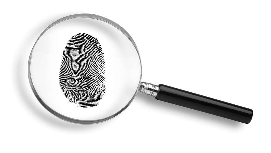 magnifying glass and thumb print on white background.  CRIME DETECTIVE THUMBPRINT MAGNIFYING GLASS FINGERPRINT FOTOLIA Photo: James Steidl / Fotolia / handout / stock agency