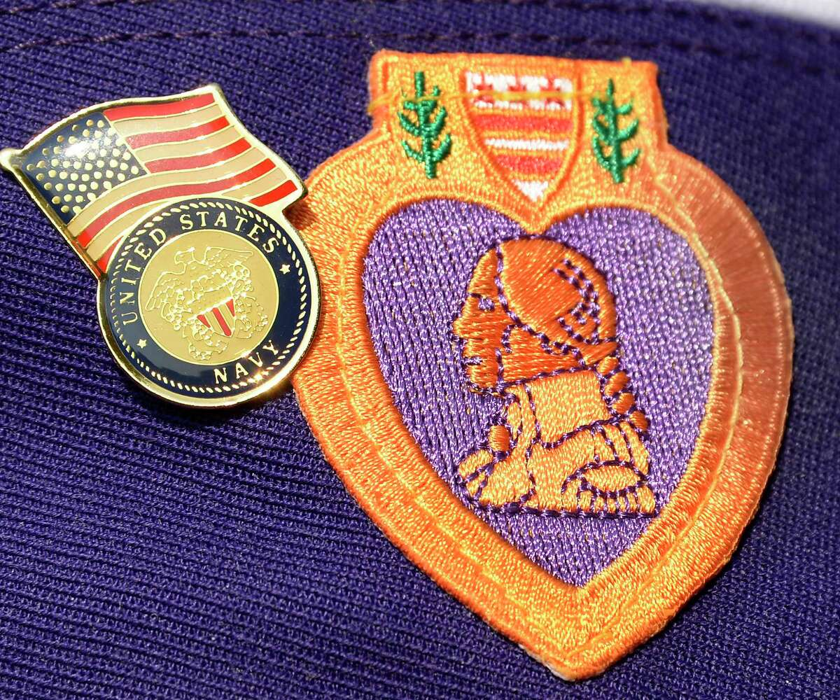 Insignia on the cap of a member of the Military Order of the Purple Heart during the Town of Halfmoon's Ceremony To Commemorate National Purple Heart Day Tuesday August 7, 2018 in Halfmoon, NY. (John Carl D'Annibale/Times Union)