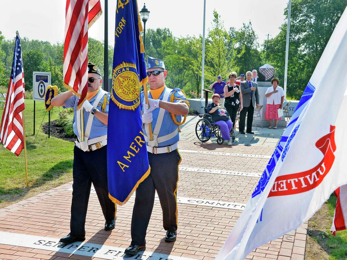 Members of American Legion Post 1450 act as Color Guard as the Town of Halfmoon holds a ceremony to commemorate National Purple Heart Day Tuesday August 7, 2018 in Halfmoon, NY. (John Carl D'Annibale/Times Union)