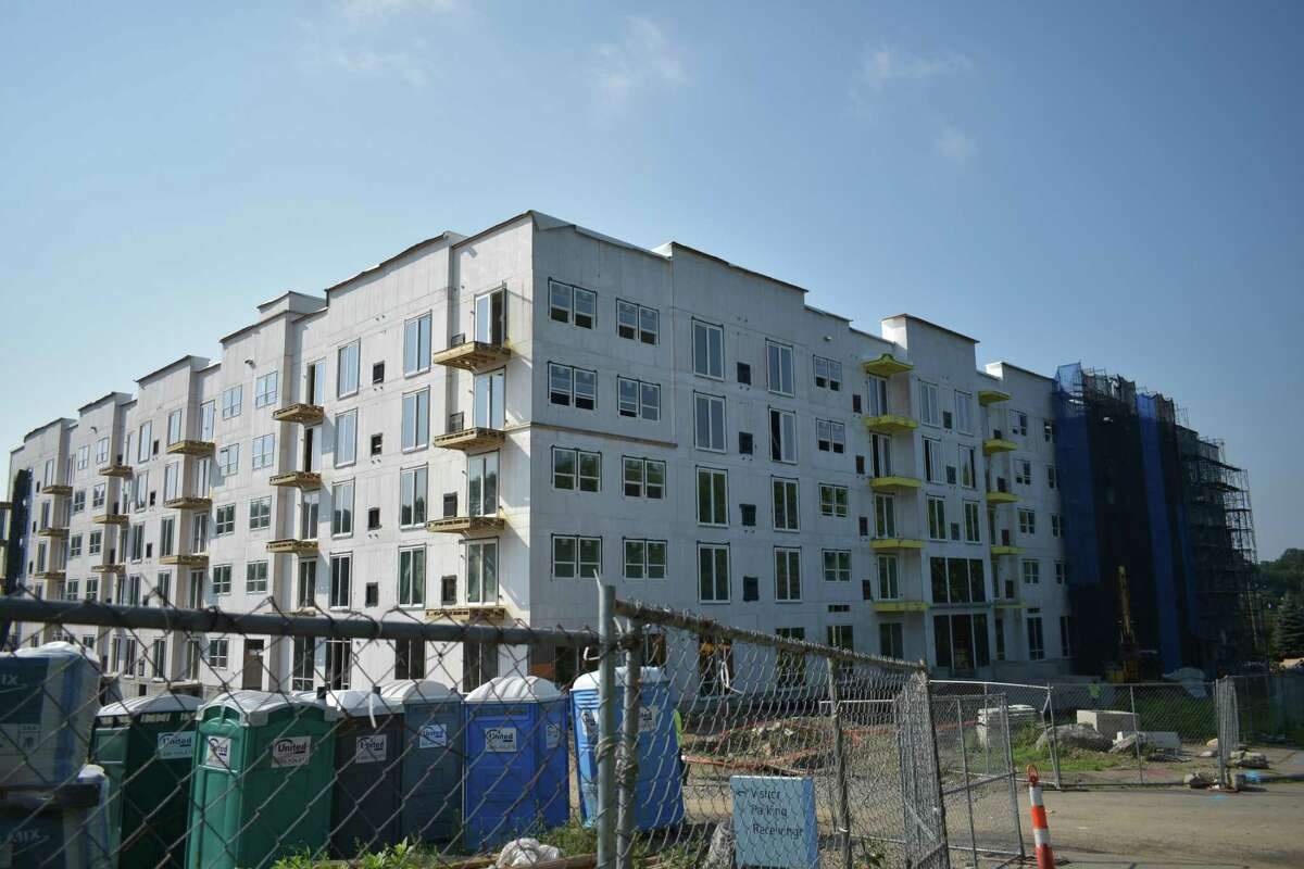 Construction continues in early August 2018 of the Curb apartment complex, formerly known as Grist Mill Village, an apartment complex on Glover Avenue in Norwalk, Conn. from the Stamford-based developer Building and Land Technology.