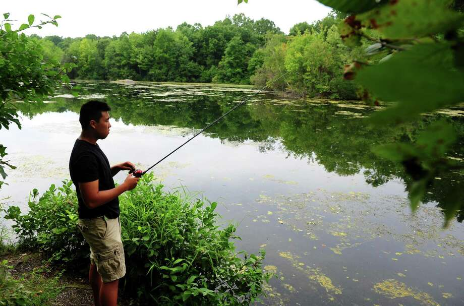 File photo of someone fishing at Mondo Ponds in Milford, Conn. Photo: Christian Abraham / Hearst Connecticut Media / Connecticut Post