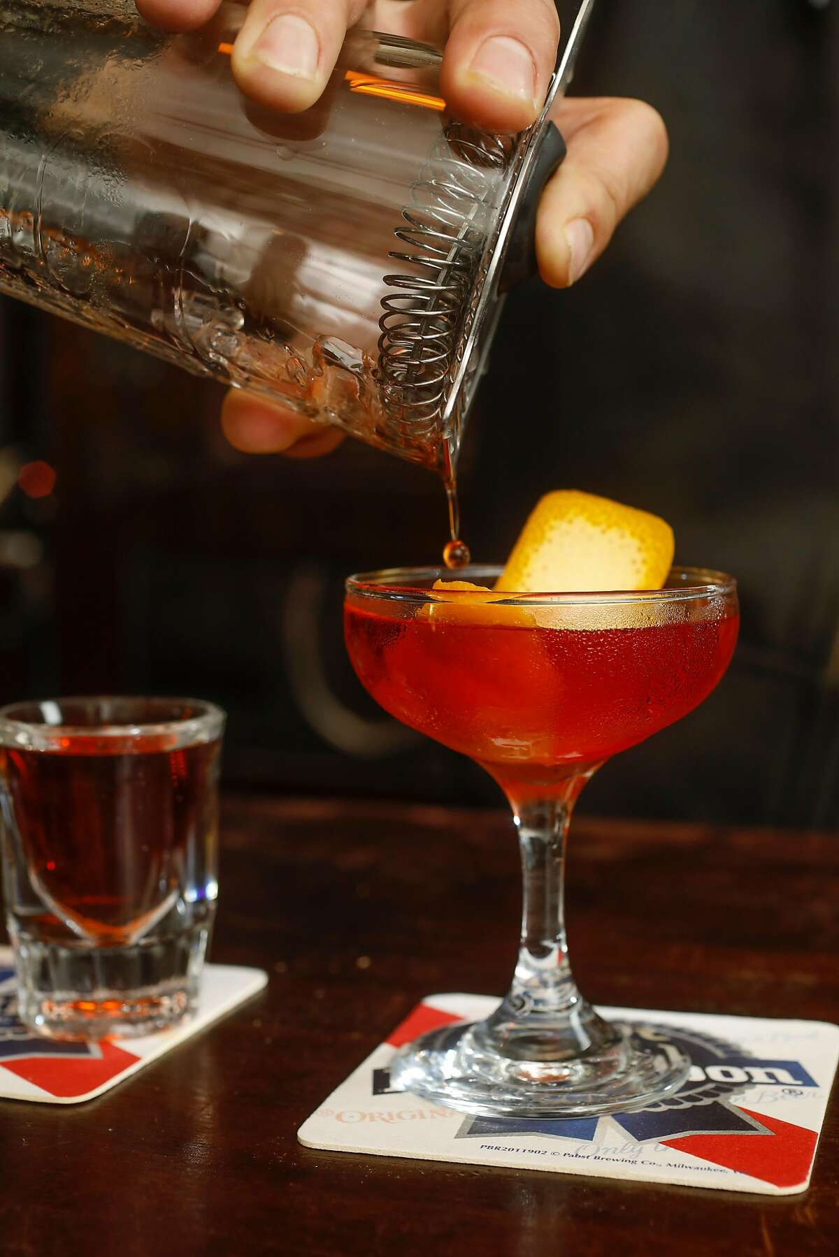 A Mescal Negroni at Wooden Nickel, a dive bar in the Mission district as seen in San Francisco, California, on August 6, 2018.