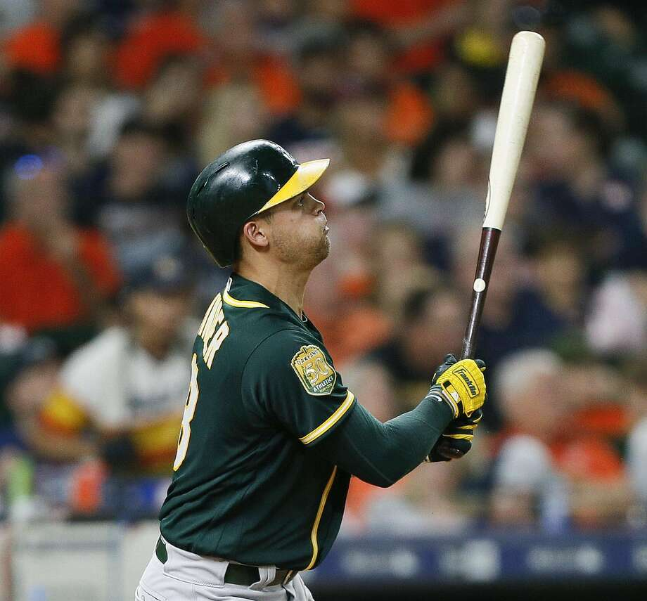 HOUSTON, TX - JULY 11:  Chad Pinder #18 of the Oakland Athletics hits a three-run home run in the fourth inning against the Houston Astros at Minute Maid Park on July 11, 2018 in Houston, Texas.  (Photo by Bob Levey/Getty Images) Photo: Bob Levey / Getty Images