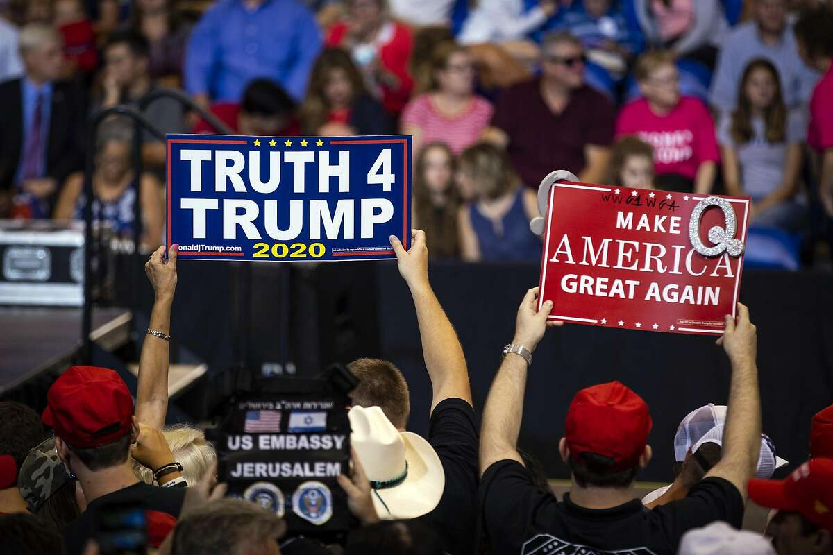 """A supporter of President Donald Trump holds up a sign referencing QAnon, a fringe movement that discusses several loosely connected and vaguely defined - and baseless - conspiracy theories, during a rally Thursday night, Aug. 2, 2018, in Wilkes-Barre, Pa. Trump devoted the majority of his time targeting the news media, deriding the reporters present as """"fake, fake disgusting news."""" (Al Drago/The New York Times) KEEP CLICKING TO SEE TWITTER REACTION TO THE TEST ALERT."""