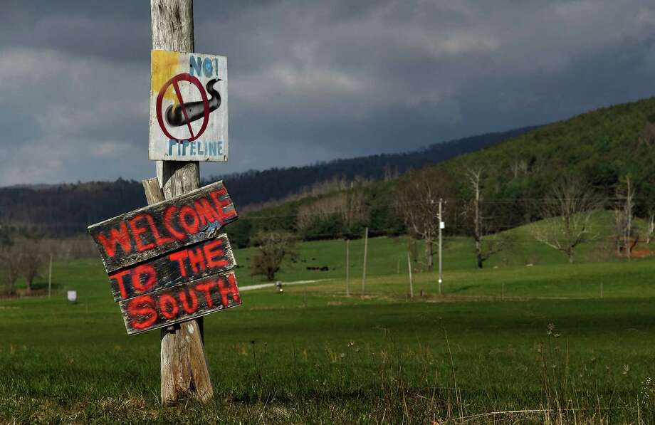 Hand painted signs along the roads near Bent Mountain, Virginia signal community opposition to the Mountain Valley Pipeline Project. Photo: Washington Post Photo By Michael S. Williamson. / The Washington Post