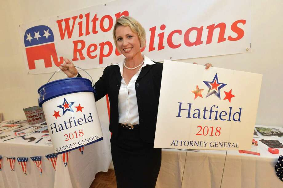 Republican candidate for Attorney General, Sue Hatfield holds up her highway tolls Bucket and a campaign sign during the Wilton Republican Town Committee kickoff at their headquarters in Wilton Conn. Monday July 30, 2018 Photo: Alex Von Kleydorff / Hearst Connecticut Media / Norwalk Hour