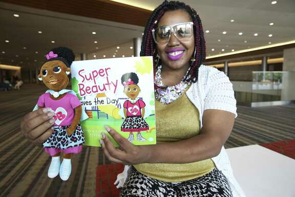 Artist Tiffany Joyce Wider, known as TiffanyJ, displays her Super Beauty book and doll at the 109th National Association for the Advancement of Colored People (NAACP) Convention in San Antonio, Texas. TiffanyJ and her Super Beauty doll were at the convetion to cheer on her local team at the Afro-Academic, Cultural, Technological and Scientific Olympics (ACT-SO).