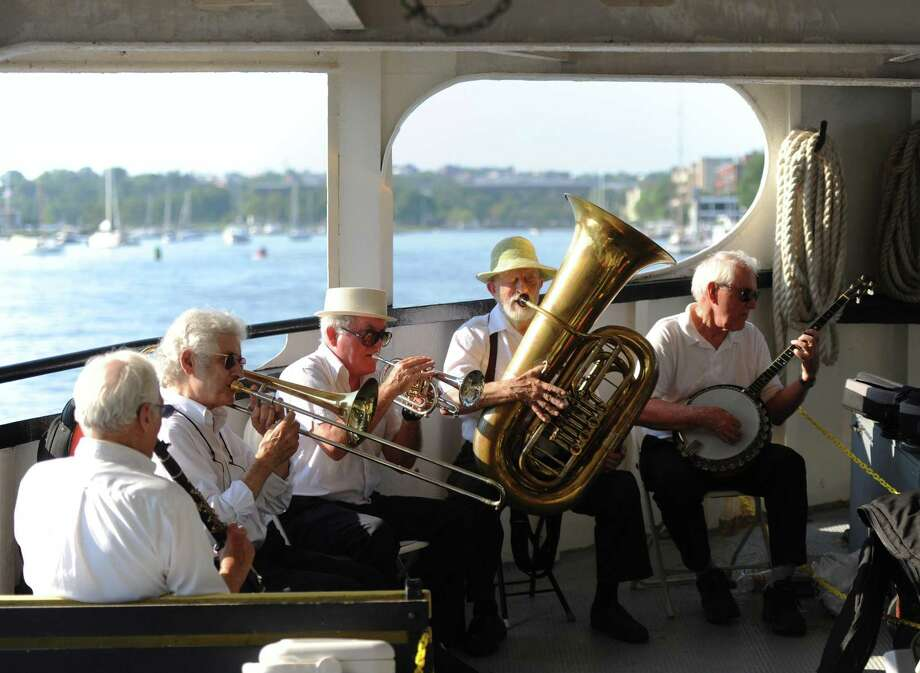 Hedge Fund Rascals members, from left, Joe Licari, Tom Artin, Tom Keegan, Bill Crow, and Gim Burton, perform on the Island Beach Ferry as part of the Dixieland Jazz Band Concerts on the Sound series in Greenwich. The traditional New Orleans-style jazz band performed on Island Beach as well as on the ferry to and from the island. Photo: Tyler Sizemore / Hearst Connecticut Media / Greenwich Time