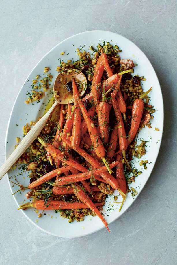 """Orange carrot freekeh with cranberries and walnuts. Photo: Used With Permission From """"Salad Feasts"""" By Jessica Elliott Dennison, Published By Hardie Grant Books July 2018 / Matt Russell"""