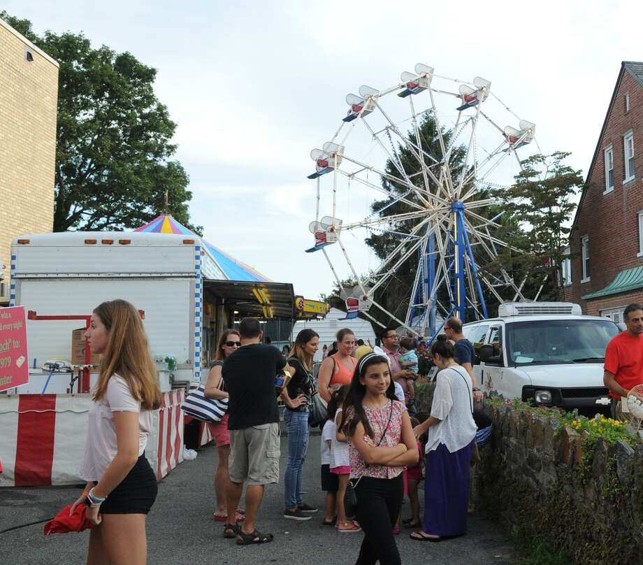 The annual St. Roch's Feast at St. Roch Church in the Chickahominy section of Greenwich, features live music, food, games, rides and entertainment along St. Roch's Avenue. The event, a major fundraiser for St. Roch's Church, will be held from 6 to 10:30 p.m. Wednesday and Thursday and from 6 to 11 p.m. Friday and Saturday. Photo: File / Bob Luckey Jr. / Hearst Connecticut Media / Greenwich Time