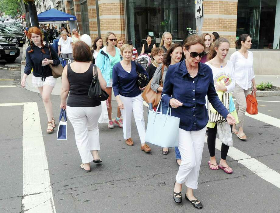 Shoppers throng Greenwich Avenue in July 2015 during the annual Sidewalk Sale Days sponsored by the Greenwich Chamber of Commerce. Michelle Farmer Collaborative is the latest luxury boutique to plan a shop in Greenwich, having yet to disclose a target opening date and address. Photo: Bob Luckey Jr. / Hearst Connecticut Media / Greenwich Time
