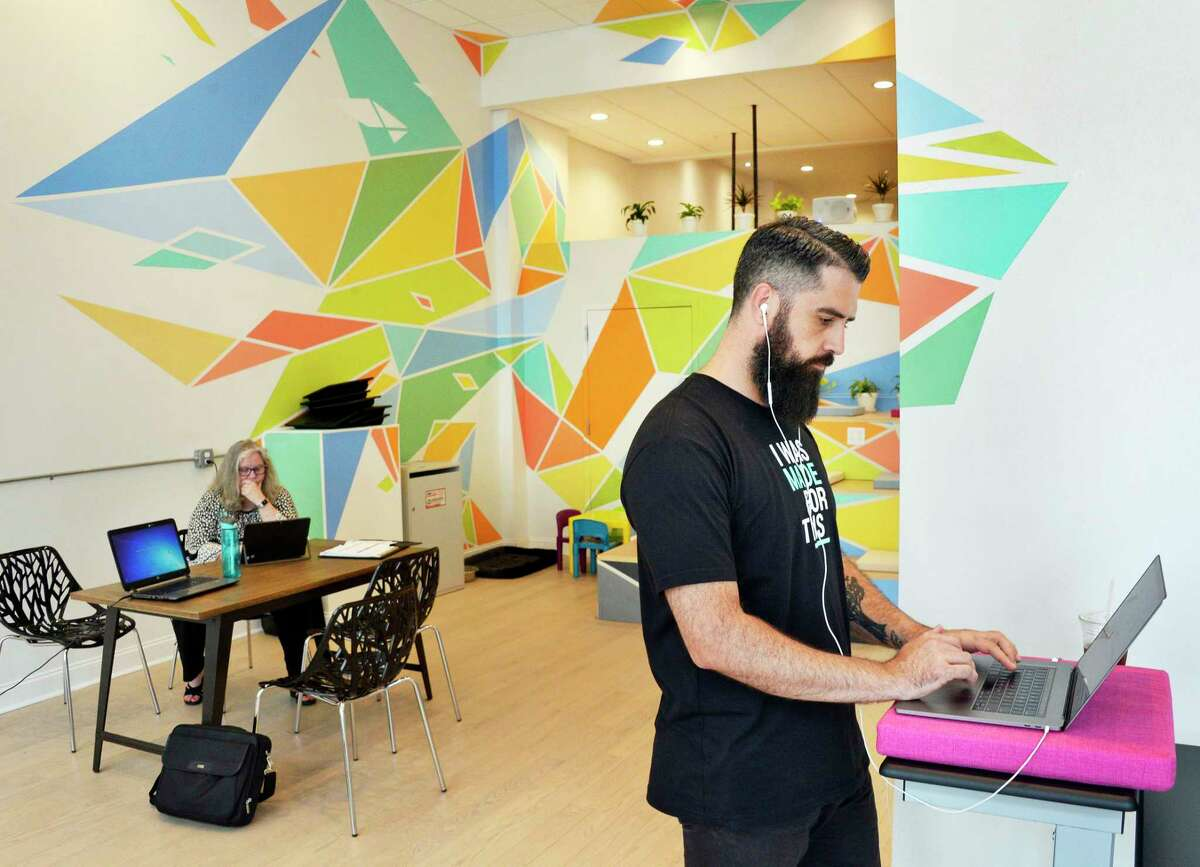 David Mazzella of Albany works at Colab, a co-working space on Broadway Tuesday August 7, 2018 in Albany, NY. (John Carl D'Annibale/Times Union)