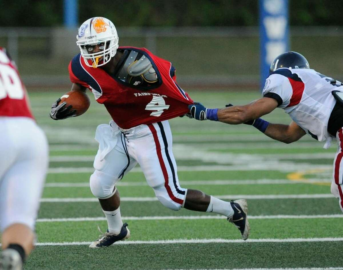 Eric Joyner, #4, running back for the Fairfield County all-stars takes the ball upfield during the New Haven County vs. Fairfield County all-star high school football game Ken Strong Stadium, West Haven High School, Friday evening, July 9, 2010.