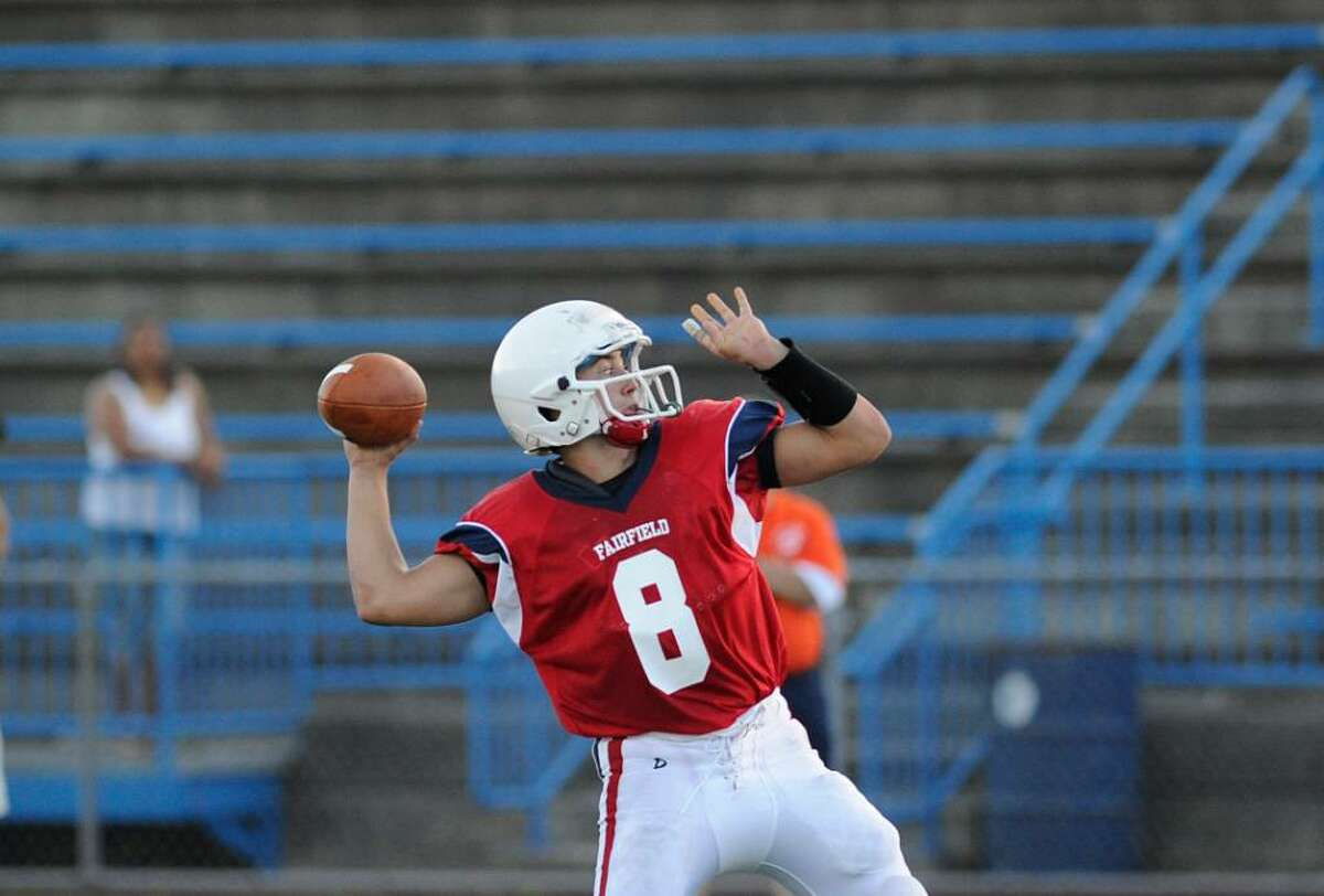 Mike Lefflbine quarterback for the Fairfield County all-stars throws during the New Haven County vs. Fairfield County all-star high school football game Ken Strong Stadium, West Haven High School, Friday evening, July 9, 2010.