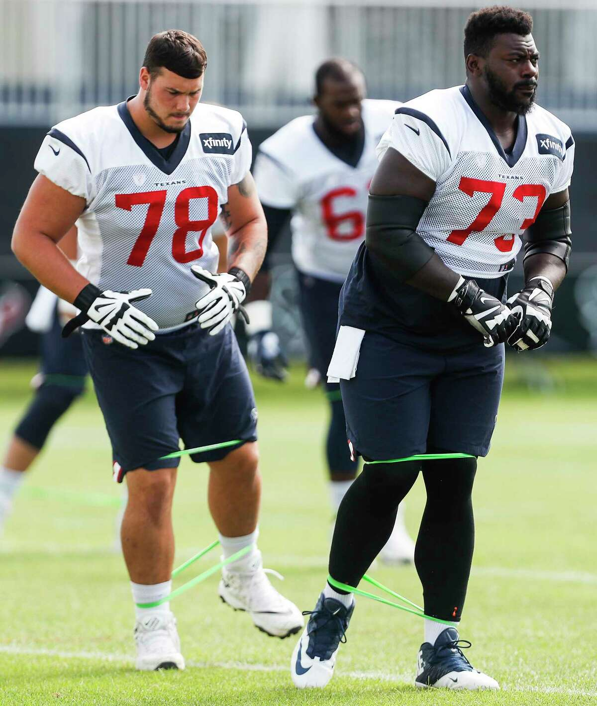 Houston Texans offensive guards Anthony Coyle (78) and Zach Fulton (73) warm up during training camp at the Greenbrier Sports Performance Center on Tuesday, Aug. 7, 2018, in White Sulphur Springs, W.Va.