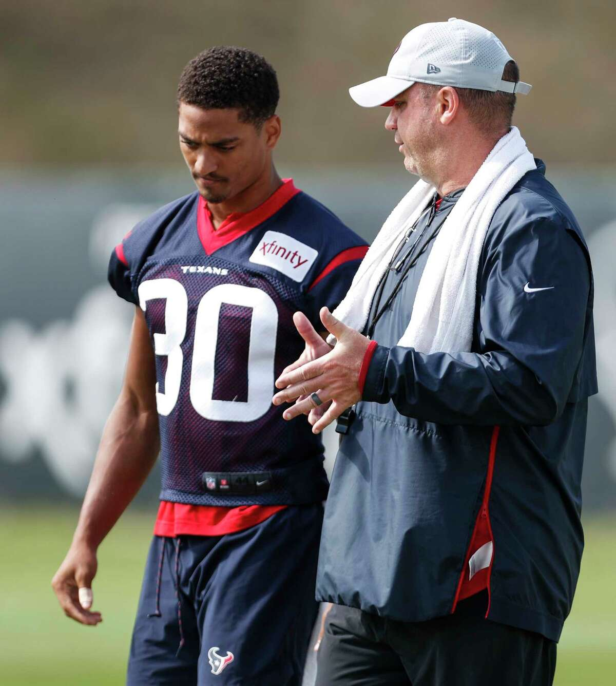 Houston Texans head coach Bill O'Brien, right, talks to cornerback Kevin Johnson (30) during training camp at the Greenbrier Sports Performance Center on Tuesday, Aug. 7, 2018, in White Sulphur Springs, W.Va.