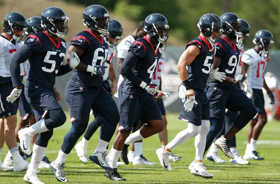 Houston Texans players warm up during training camp at the Greenbrier Sports Performance Center on Tuesday, Aug. 7, 2018, in White Sulphur Springs, W.Va. Photo: Brett Coomer, Houston Chronicle / © 2018 Houston Chronicle