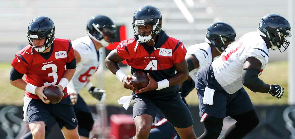 Houston Texans quarterbacks Brandon Weeden (3) and Deshaun Watson (4) drop back to fake a handoff during training camp at the Greenbrier Sports Performance Center on Tuesday, Aug. 7, 2018, in White Sulphur Springs, W.Va.