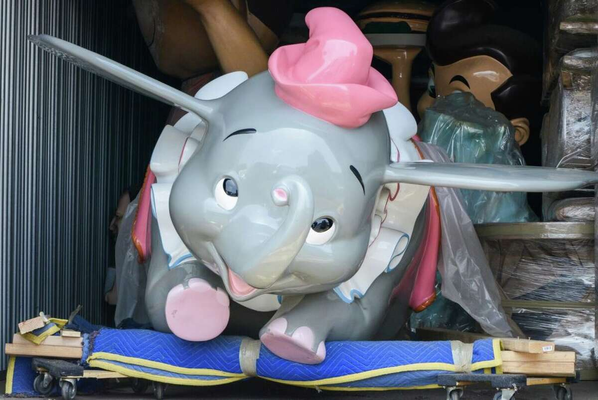 This Dumbo the Flying Elephant attraction vehicle is among the items for sale as part of the