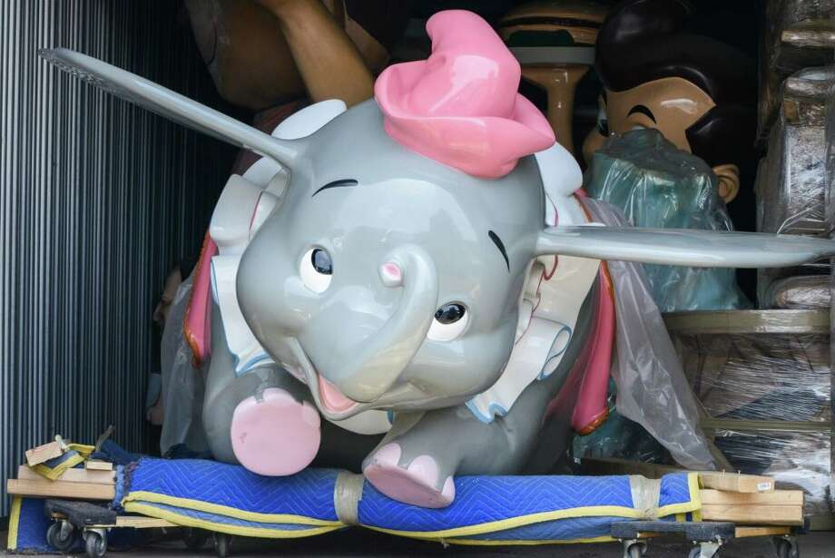 "This Dumbo the Flying Elephant attraction vehicle is among the items for sale as part of the ""That's From Disneyland!"" auction being held this month. This vehicle is estimated to fetch between $100,000 to $150,000.