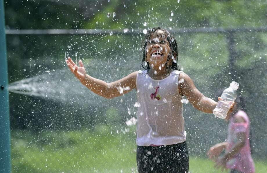 Elia Backus, 5, cools off at the Highland Avenue Spray Park in Danbury Tuesday, August 7, 2018. Photo: Carol Kaliff / Hearst Connecticut Media / The News-Times
