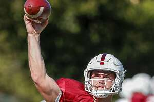 Stanford quarterback Davis Mills (15) throws a ball while doing drills during Stanford football practice at Stanford, Calif., on Monday, August 6, 2018.