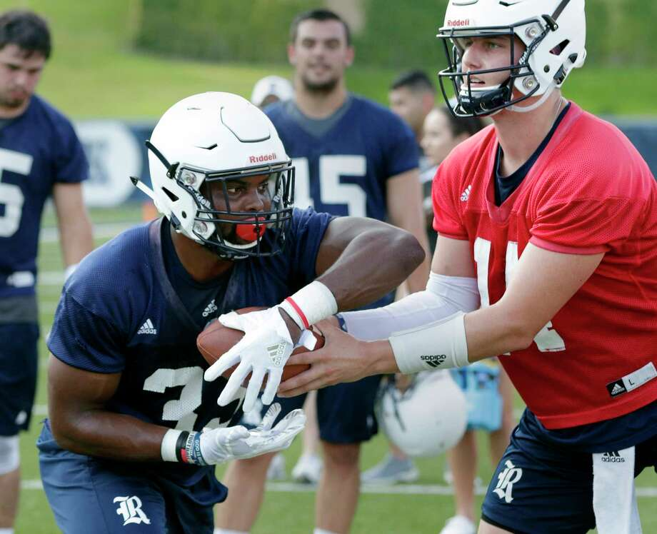 Rice University running back Emmanuel Esukpa (33) takes a hand off from Jackson Tyner during a football practice at Rice Stadium Friday July 27, 2018 in Houston, TX. 