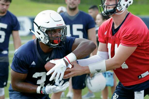 Rice University running back Emmanuel Esukpa (33) takes a hand off from Jackson Tyner during a football practice at Rice Stadium Friday July 27, 2018 in Houston, TX. Michael Wyke/Contributor