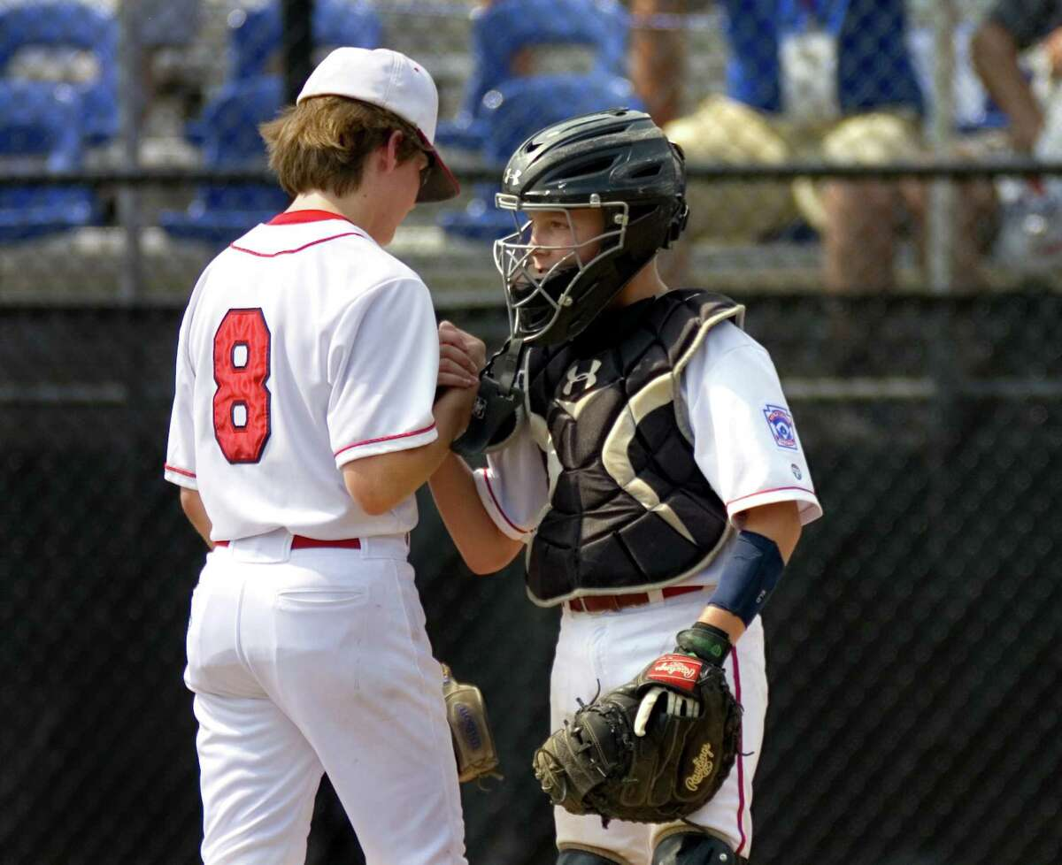 Fairfield American pitcher Pierce Cowles and catcher Timmy Domizio shake hands after beating Maine.