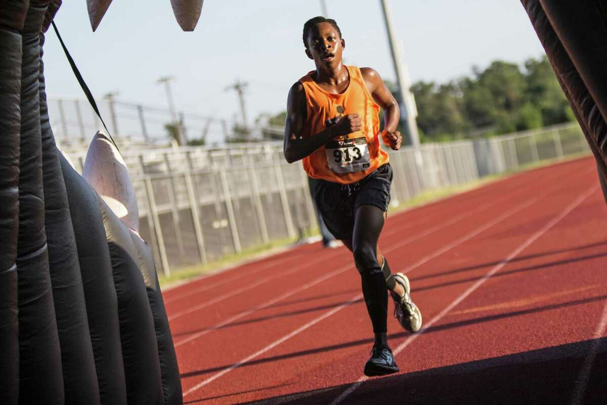 Ishmail Jackson finishes first overall during the Melon Run '14 benefitting the Kingwood Park Cross Country team Aug. 16, 2014, at Kingwood Park High School.
