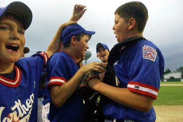 Northeast Little League players celebrate a win over Union Township in the major district tournament in July 2003. (Daily News file photo)