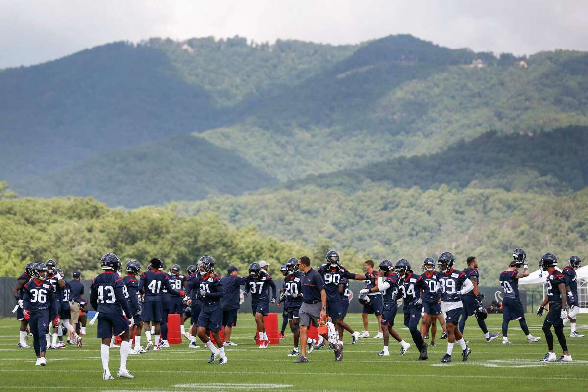 The Houston Texans defense gathers on the field for the start of training camp at The Greenbrier Sports Performance Center on Thursday, July 26, 2018, in White Sulphur Springs, W.Va.