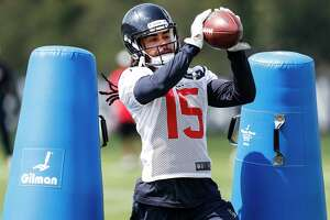 Houston Texans wide receiver Will Fuller (15) makes a catch during training camp at The Greenbrier Sports Performance Center on Thursday, July 26, 2018, in White Sulphur Springs, W.Va.