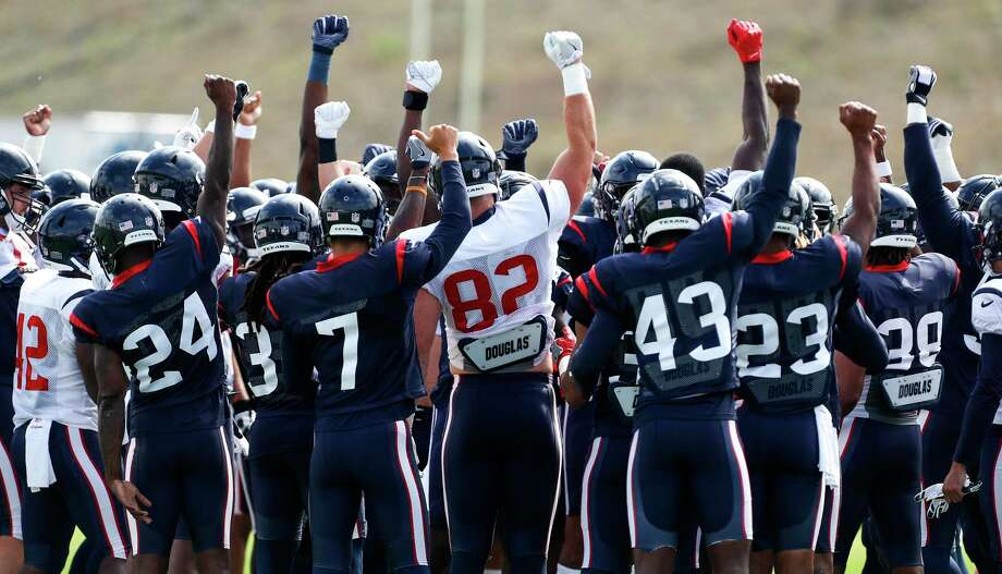 Houston Texans players raise their fists as they gather in a huddle at the beginning of practice during training camp at the Greenbrier Sports Performance Center on Saturday, Aug. 4, 2018, in White Sulphur Springs, W.Va. Photo: Brett Coomer, Houston Chronicle / © 2018 Houston Chronicle