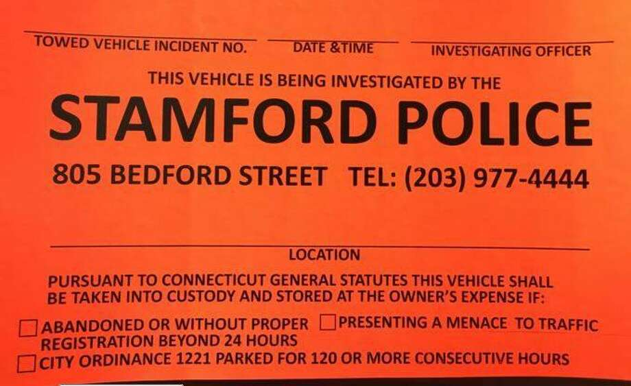 During a crackdown on abandoned cars around Stamford, police have been affixing these stickers, warning owners that their vehicles could be towed away. Photo: Stamford Police / Contributed